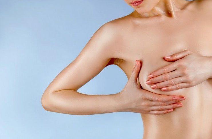 Выделения из груди перед месячными и причины их появления