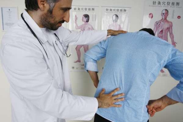 Болит низ спины у мужчин